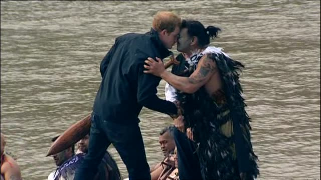 prince harry disembarking after paddling in waka with local māori on whanganui river and sharing hongi with helmsman - new zealand culture stock videos and b-roll footage