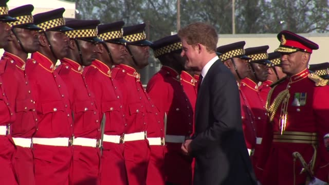 prince harry disembarks royal salute and inspection of the guard prince harry is on a four day tour of jamaica as part of the queen's diamond jubilee... - emma brumpton stock videos & royalty-free footage