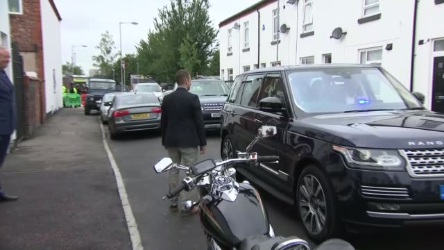 Manchester EXT Prince Harry from car and responds to reporter SOT re being an uncle for the third time