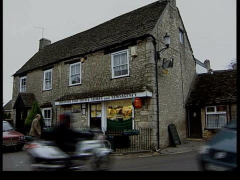 police involvement itn england wiltshire sherston rattlebone inn pub where prince harry is alleged to have got drunk zoom in minder standing at door... - inn stock videos & royalty-free footage