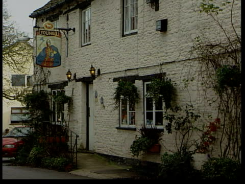 police involvement itn wiltshire sherston ms 'rattlebone inn' sign over door of pub where harry is alleged to have got drunk gvs rattlebone inn pub... - inn stock videos and b-roll footage