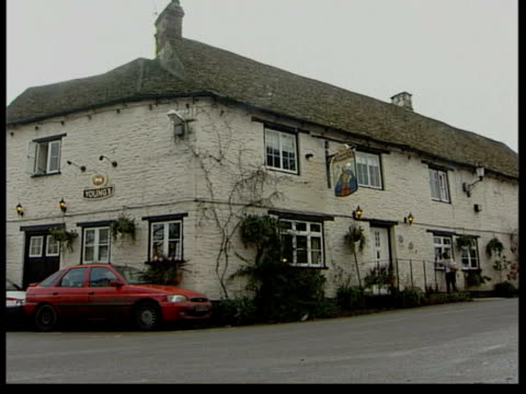 police involvement itn wiltshire sherston gv pub ms 'rattlebone inn' sign over door gv pub - inn stock videos & royalty-free footage