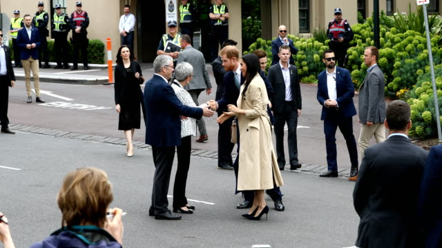 Prince Harry Duke of Sussex and Meghan Duchess of Sussex are greeted by Governor of Victoria Linda Dessau and Mr Anthony Howard QC on October 18 2018...