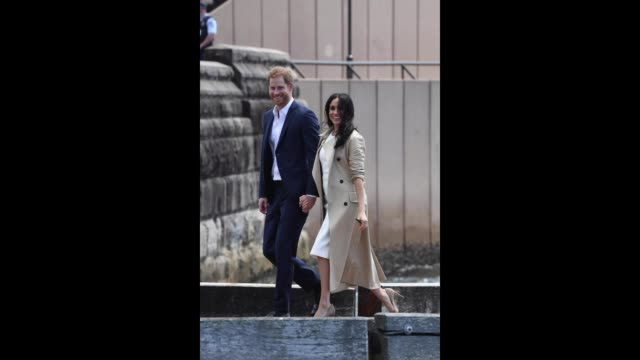 Prince Harry Duke of Sussex and Meghan Duchess of Sussex arrive at Man o'War Steps a wharf next to the Sydney Opera House on October 16 2018 in...