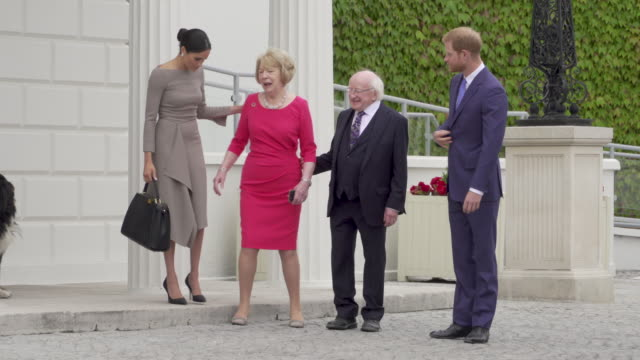 Prince Harry Duke of Sussex and Meghan Duchess of Sussex President Michael D Higgins Sabina Coyne leaving at Aras an Uachtarain during day two of...