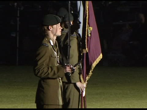 eton cadets parade; england: berkshire: eton: eton college: ext / night side combined cadet force's band along past as playing at eton's ccf annual... - lighting technique stock videos & royalty-free footage