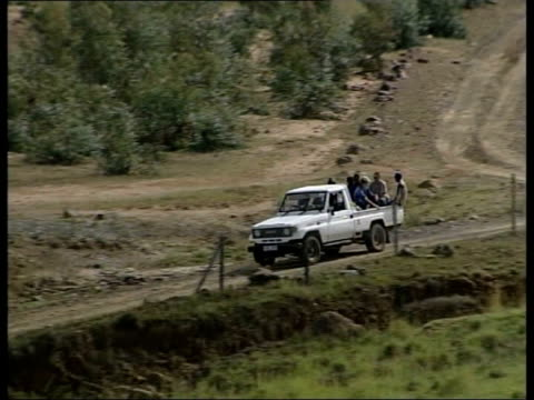 gap year in lesotho; b)itv evening news: neil connery itn lesotho: ext lms pick-up truck along track carrying prince harry prince harry, with new... - itv evening news stock-videos und b-roll-filmmaterial