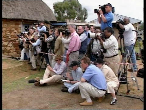 gap year in lesotho cms prince harry working at fence prince harry walking along next fence pan cms prince harry speaking to press sot cutaway ms... - 2004 stock-videos und b-roll-filmmaterial