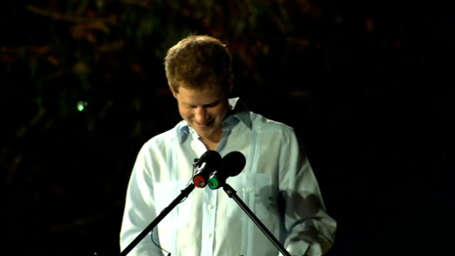 prince harry gives speech and attends street party in belize; belize: belmopan: ext / night **beware flash photography** prince harry on stage next... - diamantenes jubiläum stock-videos und b-roll-filmmaterial
