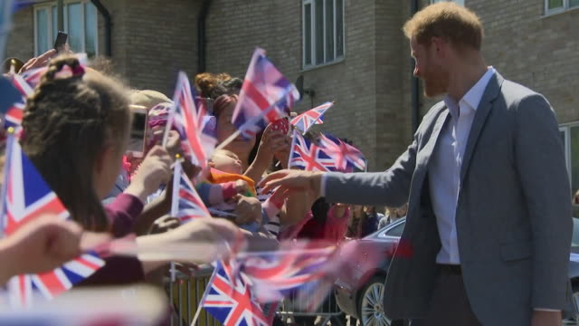 prince harry greets cheering crowds as he visits barton neighbourhood centre in oxford - flag stock videos & royalty-free footage