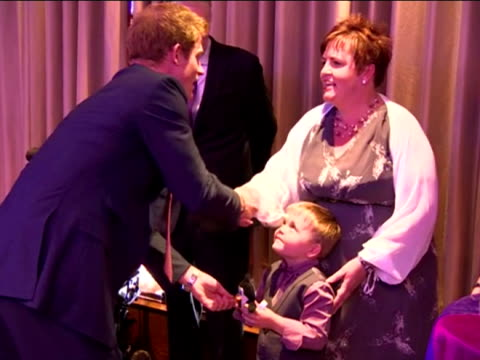 stockvideo's en b-roll-footage met prince harry is making his first official public appearance since pictures of him naked were published by an american website. as patron of the sick... - verschijning