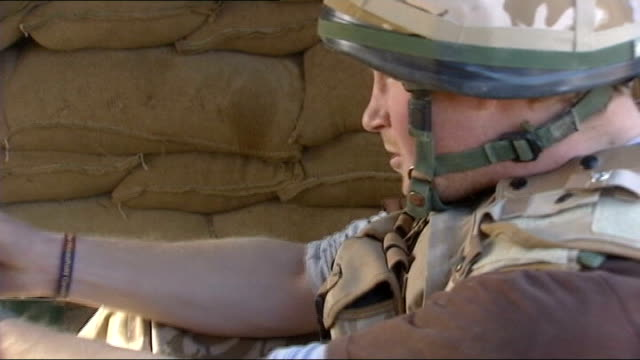 prince harry is serving in afghanistan; afghanistan: helmand province: ext prince harry firing a .50 calibre machine gun as gurkha soldier helps int... - helmand stock videos & royalty-free footage