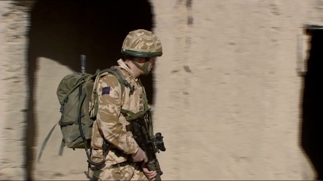 prince harry is serving in afghanistan afghanistan helmand province ext prince harry firing a 50 calibre heavy machine gun as gurkha soldier helps... - afghanistan stock videos & royalty-free footage