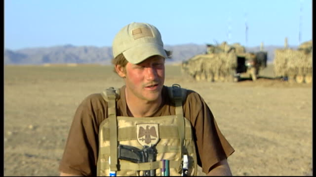vídeos de stock e filmes b-roll de prince harry is serving in afghanistan jet flying in sky prince harry speaking on field telephone prince harry interview sot yesterday we bumped into... - encontrar