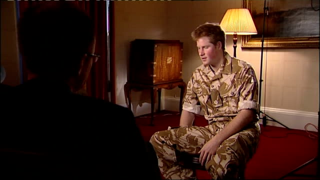 vídeos de stock, filmes e b-roll de prince harry interview before his deployment wristbands worn by prince harry / camera pans around during remainder of interview including shots of... - 2008
