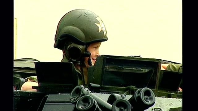 vídeos y material grabado en eventos de stock de prince harry is serving in afghanistan tx young prince harry along / wearing an army helmet on board an apc - 1993