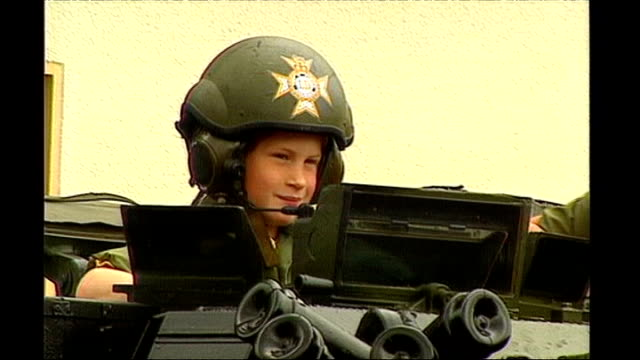 vídeos y material grabado en eventos de stock de prince harry is serving in afghanistan tx **wharfe interview overlaid sot** a young prince harry wearing an army helmet on board an apc - 1993