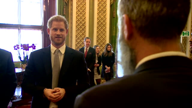 prince harry jokes with comic adam hill about his beard at buckingham palace reception for rugby league world cup 2021 draw - human body part stock videos & royalty-free footage