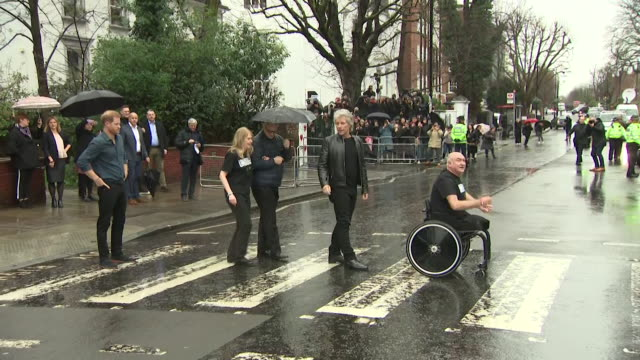 prince harry jon bon jovi and two members of the invictus games choir recreate the famous beatles pose on the zebra crossing outside abbey road... - crossing stock videos & royalty-free footage
