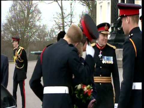 Prince Harry kisses Camilla Duchess of Cornwall after his passing out parade whilst standing alongside Prince William at Royal Military Academy...