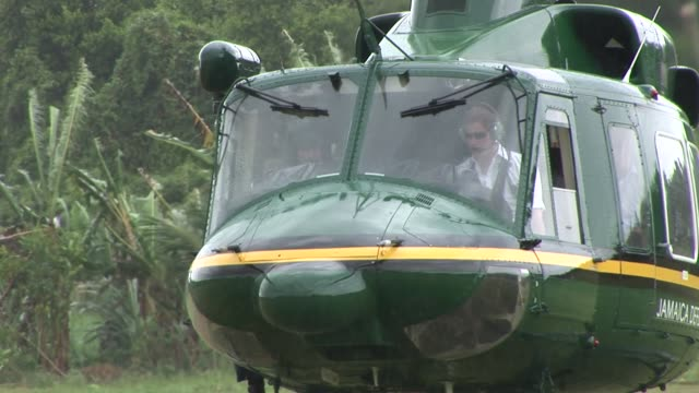 prince harry lands a helicopter having flown in from kingston landing at the william knibb memorial high school falmouth trelawny as part of his tour... - emma brumpton stock videos & royalty-free footage