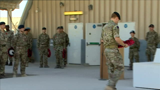 vídeos de stock e filmes b-roll de prince harry lays wreath during remembrance day service in kandahar afghanistan kandahar airfield ext prince harry lays wreath at remembrance day... - kandahar