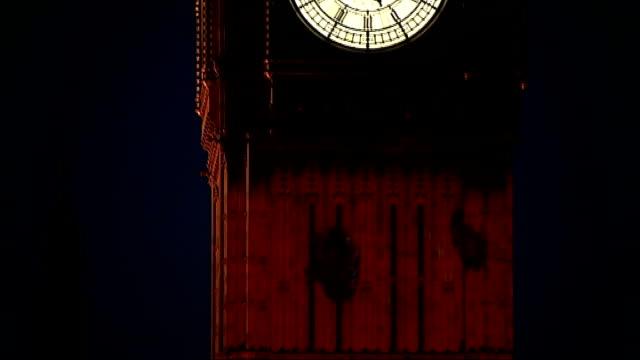 vídeos de stock e filmes b-roll de prince harry lays wreath during remembrance day service in kandahar england london ext / night big ben clock face showing 515pm tilt down to show... - kandahar