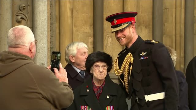 Prince Harry leads Armistice commemorations ENGLAND London Westminster EXT Prince Harry Duke of Sussex posing for photograph with chatting veteran...