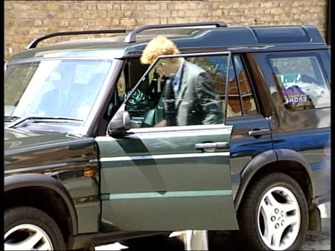 stockvideo's en b-roll-footage met prince harry leaves eton; pool england: eton: ext prince harry along as raises fists in celebration before getting into car prince harry & friend... - blazer