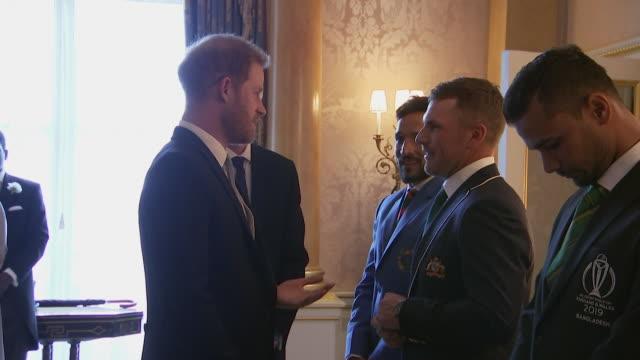 Prince Harry meets 2019 Cricket World Cup team captains Australia's Aaron Finch and Bangladesh's Masrafe Bin Mortaza at Buckingham Palace event