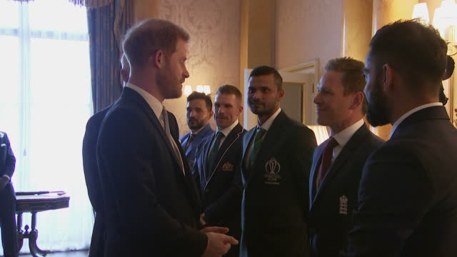 Prince Harry meets 2019 Cricket World Cup team captains England's Eoin Morgan and India's Virat Kohli at Buckingham Palace event