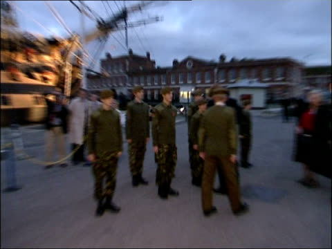 prince harry meets sea cadets and tours hms victory at portsmouth prince harry along to greet soldiers and sailors on parade **flash photography**... - admiral nelson stock videos and b-roll footage