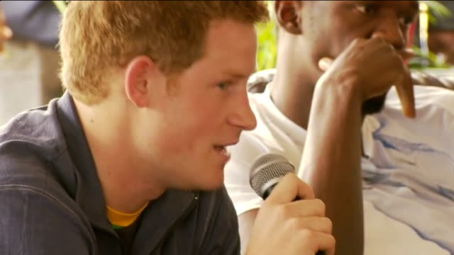 vídeos de stock, filmes e b-roll de prince harry meets usain bolt during caribbean tour *** warning close shot prince harry pan usain bolt prince harry speaking into microphone sot this... - bolt