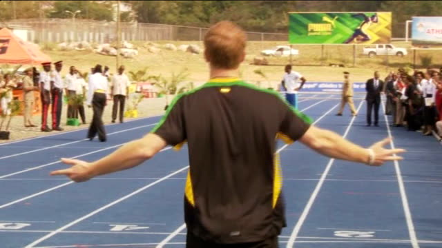 Prince Harry meets Usain Bolt during Caribbean Tour JAMAICA Kingston EXT Prince Harry on track with Usain Bolt as Harry sprints off to finish line...