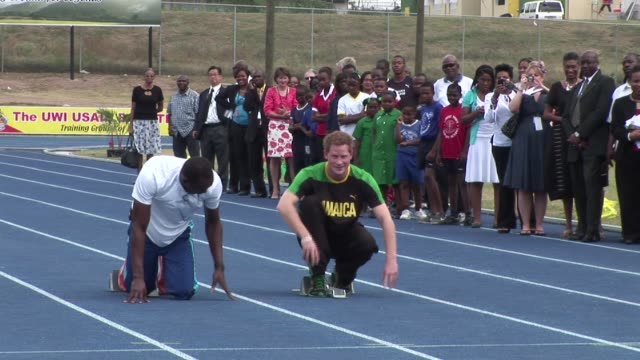 prince harry met the fastest man in the world as part of his tour of jamaica to celebrate the diamond jubilee of his grandmother queen elizabeth ii... - emma brumpton stock videos & royalty-free footage