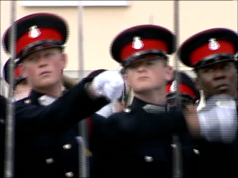 prince harry not to be sent to iraq lib surrey sandhurst ext prince harry marching in ceremonial dress in passing out parade with household cavalry... - cavalry stock videos and b-roll footage