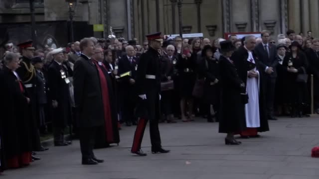 prince harry observes a minute silence at westminster abbey's field of remembrance and lays a cross to honour the fallen ahead of armistice day... - remembrance day stock videos & royalty-free footage