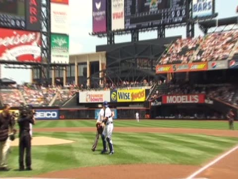 prince harry on field with new york mets during royal visit to new york - baseballmütze stock-videos und b-roll-filmmaterial