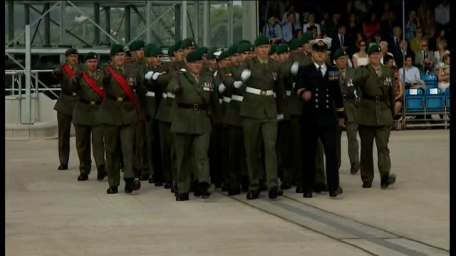 prince harry opens royal navy centre in plymouth; england: devon: plymouth: ext sailors and royal marines marching on parade square - 英国海兵隊点の映像素材/bロール
