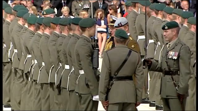 prince harry opens royal navy centre in plymouth; harry walking along the line and talking to some marines / royal marines conductor and band playing - royal marines stock videos & royalty-free footage