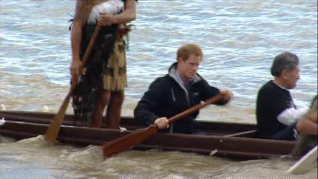 Prince Harry paddling in waka with local Māori on Whanganui River