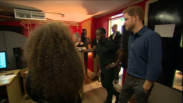 prince harry paid a visit to nottingham, his fifth in the last three years. while there he visited the community recording studio at the russell... - epic film stock videos & royalty-free footage