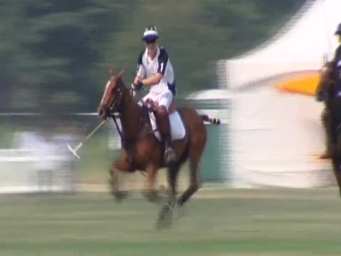 Prince Harry participates in a charity polo match during his three day royal tour of New York