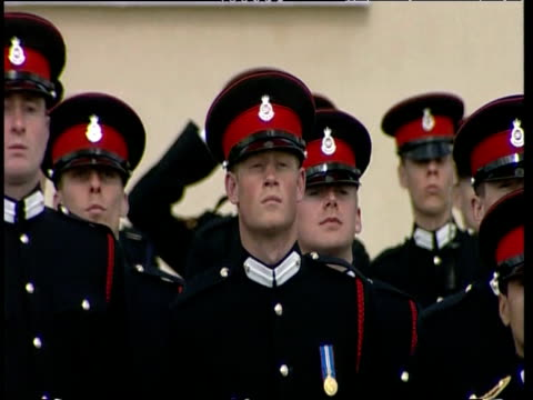 Prince Harry presents arms in dress uniform at his passing out parade Royal Military Academy Sandhurst Berkshire 12 Apr 06