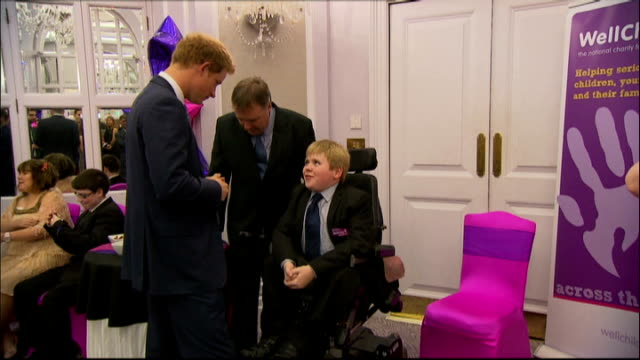 prince harry recognises bravery at wellchild awards 2014 england london photography *** prince harry meeting martin bennett before ceremony martin... - atrophy stock videos & royalty-free footage