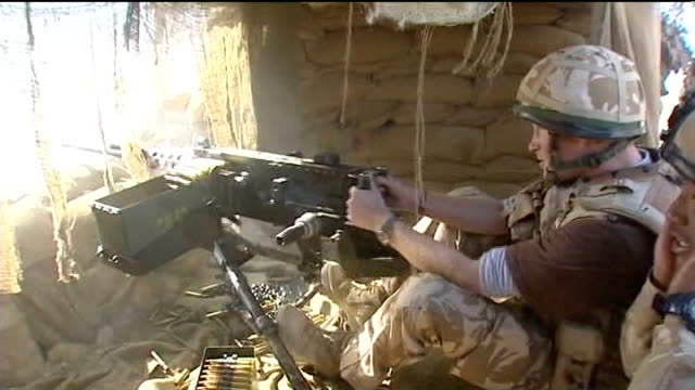prince harry returns from afghanistan; filmed between december 2007 to february 2008 afghanistan: helmand province: ext prince harry firing a .50... - helmand stock videos & royalty-free footage