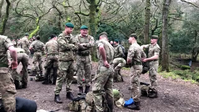 prince harry salutes and hands green berets to royal marines who have completed a 30-mile march on dartmoor. prince harry, who assumed the role of... - royal marines stock videos & royalty-free footage