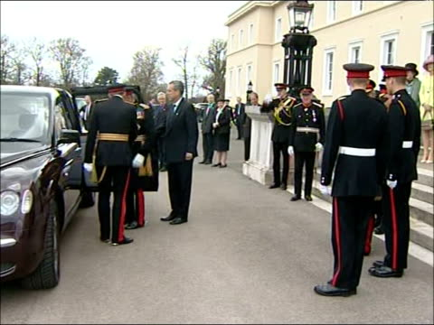 Sovereign's Parade / Queen's speech Harry and William smiling as stand next Prince Charles Harry and William saluting as Queen's car along past /...