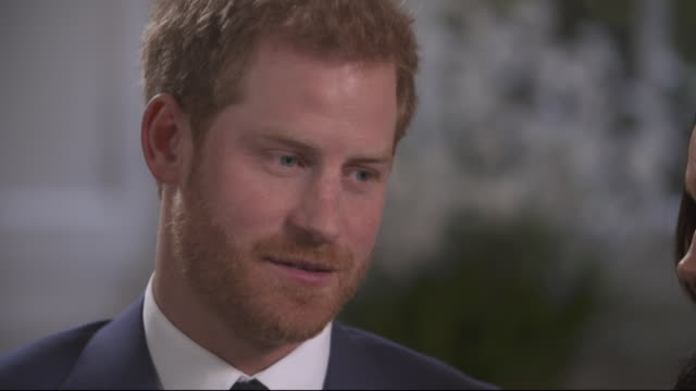 Prince Harry saying his mother Princess Diana would have been 'jumping up and down with excitement' over his engagement to Meghan Markle if she were...