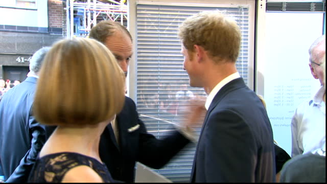 vídeos y material grabado en eventos de stock de prince harry sentebale exhibition gvs harry chatting to guests / harry interview sot he's about that long that wide crying his eyes out like all... - 2013
